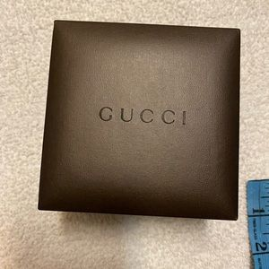 Gucci small box size 4 x4 inches it lightly used
